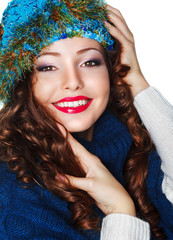 Happy Smiling Brunette wearing Knitted Blue Cap and Jersey