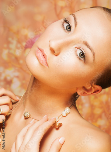 Tenderness. Portrait of Imposing Woman with Gold Pearly Chainlet