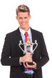 business man  with win cup in hand
