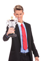 Business man giving you a trophy