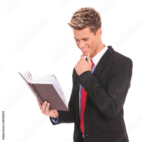 young student  reading a law book
