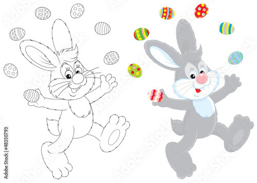 Easter Bunny juggling with painted eggs