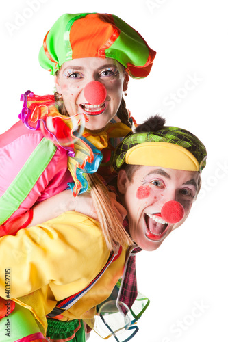 Two smiling clowns  isolated over a white background