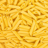 Italian Penne Rigate Macaroni Pasta raw food background or textu
