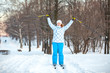 Woman sportsman on cross ski with ski-poles