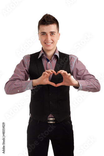 Young man making heart with fingers