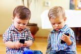 Fototapety cute baby toddlers exploring mobile phones