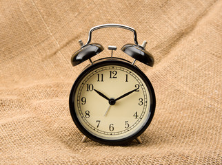 Alarm clock on linen