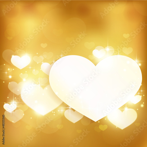 Golden glowing love heart background with lights and stars