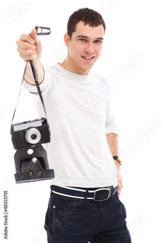 Young handsome photographer in studio