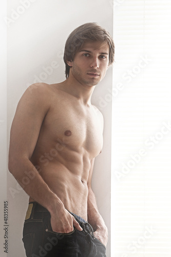 Young sexual man with naked torso