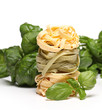 Fresh tagliatelli with spinach leaves