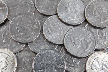 A lot of US quarter dollar coins
