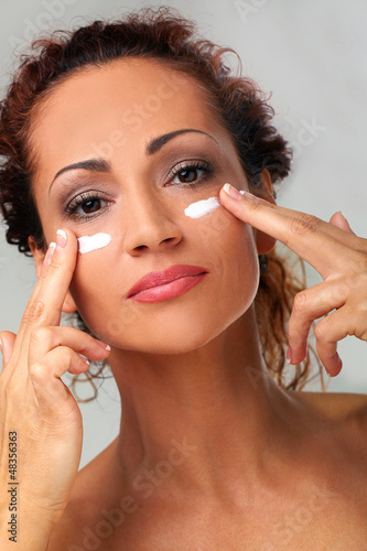 Natural middle aged woman with cream