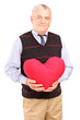 Mature gentleman holding a red heart