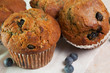 Group of fresh baked golden blueberry muffins
