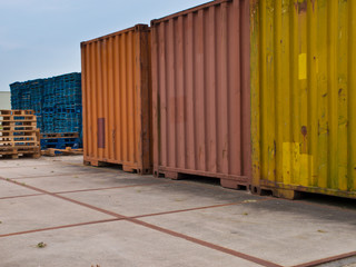 Containers and pallets on a storage lot
