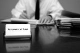 Attorney at Desk with Business Card