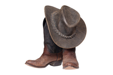 Cowboy boots and hat isolated with clipping path