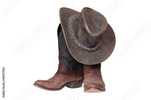 canvas print picture Cowboy boots and hat isolated with clipping path