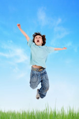 Adorable child jumping on the meadow