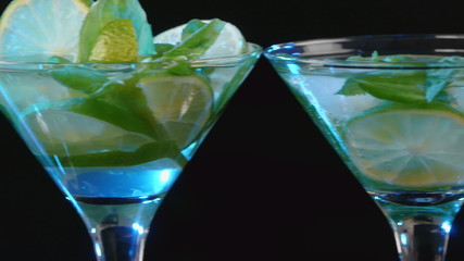 Martini cocktail with lime and mint closeup