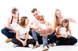 Happy family of parents and young children