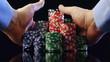 Hands taking poker chips after winning