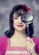 Brunette housewife with soup ladle