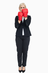 Blonde businesswoman with red gloves