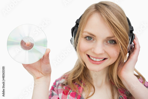 Woman smiling while holding a cd