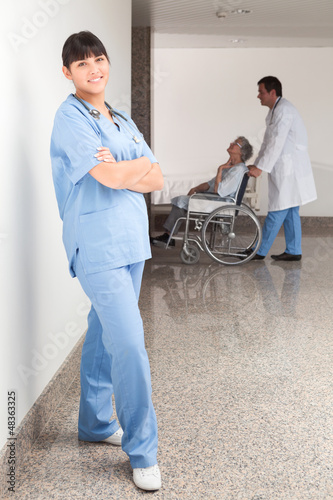 Proud nurse standing in the hallway