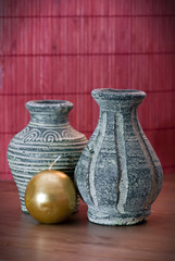 Vases of terracotta and yellow candle