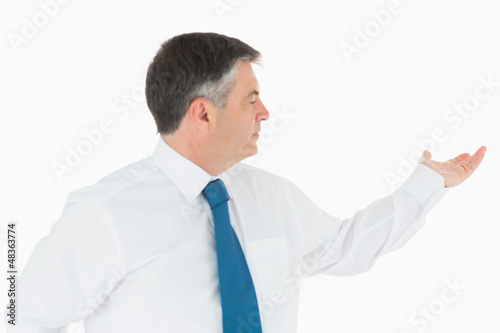 Businessman holding out hand to the right