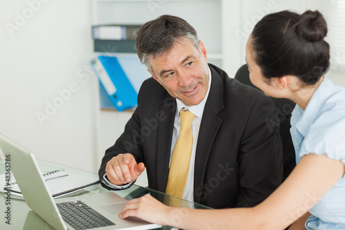 Business man and woman working together