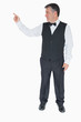 Waiter in suit pointing to something