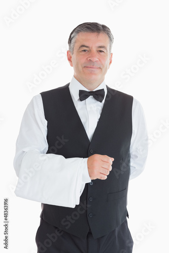 Happy man standing in suit