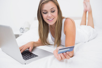 Blonde woman buying on website