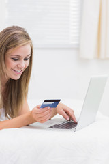Cheerful woman buying on website