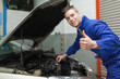 Mechanic gesturing thumbs up
