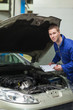 Auto mechanic inspecting car