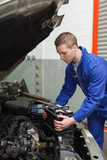 Mechanic checking car battery