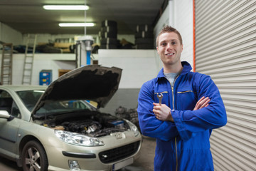 Confident male mechanic with spanner