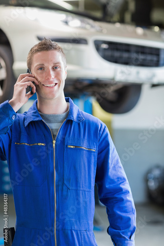 Smiling male mechanic on call