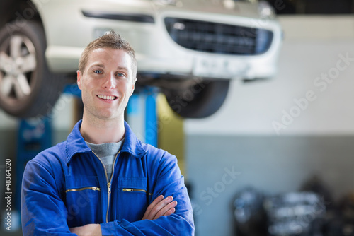 Confident young mechanic