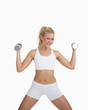 Portrait of woman exercising with dumbbells