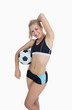 Sporty woman with football posing over white background