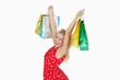 Portrait of cute excited woman holding up her shopping bags