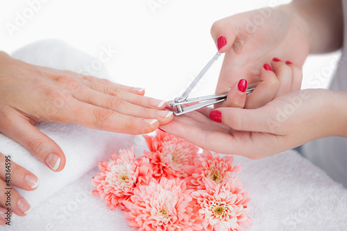 Woman cutting fingernail