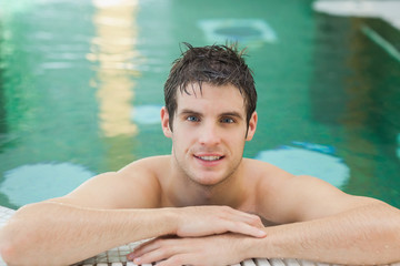 Smiling man in a swimming pool